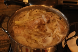 cover pork with water, add onions, and pepper. Cook uncovered for one hour.